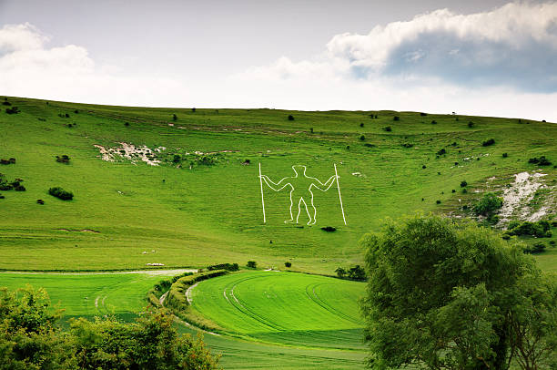 Long Man of Wilmington, a historic chalk cut  figure on a hillside in East Sussex, England